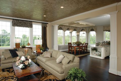 Eclectic Living Room with fabric valance window covering