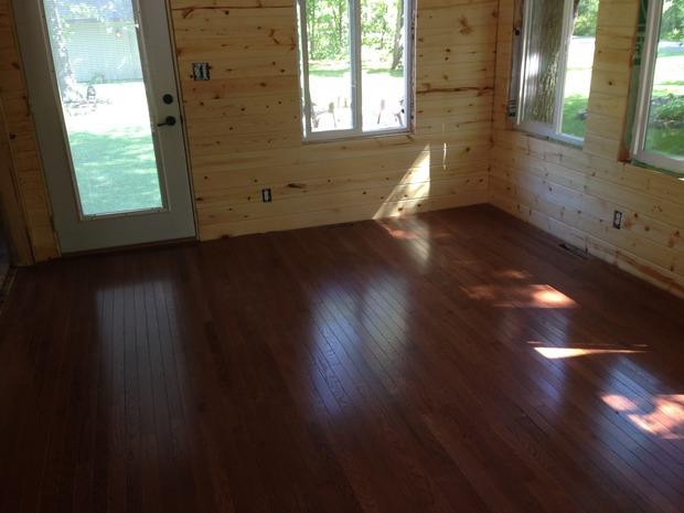 Rustic Sunroom In Rosemount Dark Wood Floor Sun Room