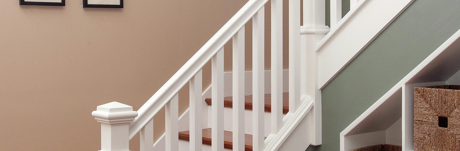 Cape Cod Staircase with built in storage under stairs