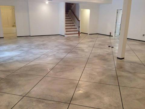 Traditional Basement with epoxy coated cement floor