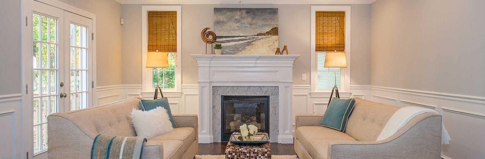 Transitional Family Room with natural fiber window coverings