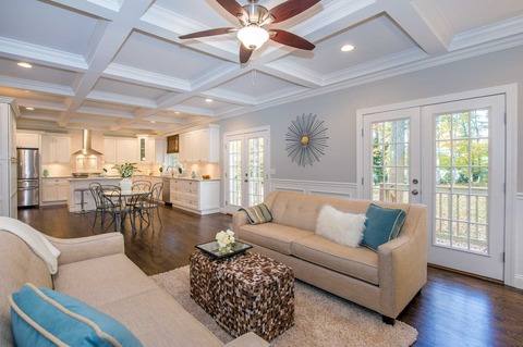 Traditional Family Room with ceiling fan with light