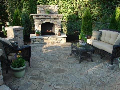 Traditional Patio with black wicker coffee table with glass top