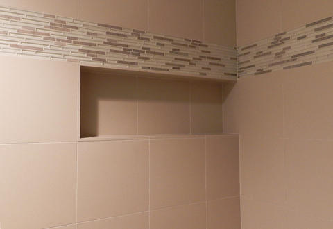 Cape Cod Bathroom with white and brown glass tile border