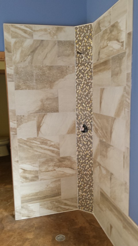 Bathroom with graduated color mosaic tile