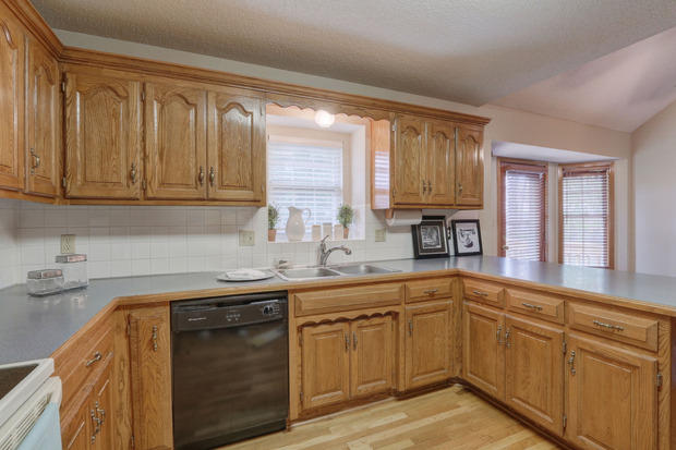 Traditional Kitchen In Overland Park Cellular Blind Drop In Double Sink By J Day Staging