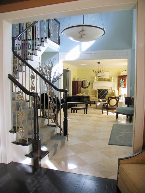 Modern Entry with blue and white striped stair runnger