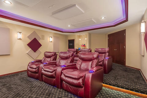 Eclectic Home Theater with red leather theater seats