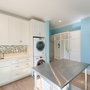 Cape Cod Mud Room with stacking full size washer and dryer