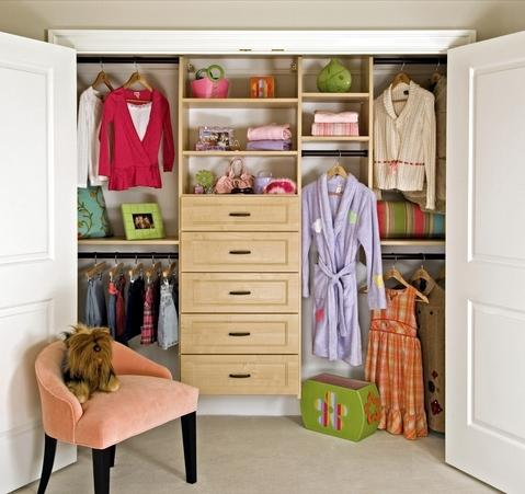 Contemporary Closet with light stained wood drawers