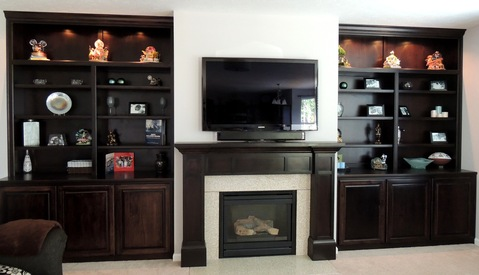 Traditional Family Room with built in cabinets flanking fireplace