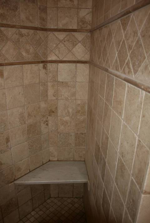 Traditional Bathroom with stone seat shower bench