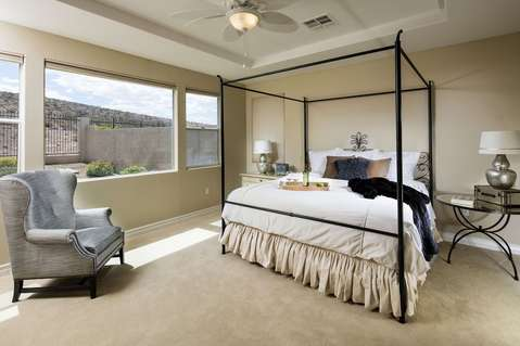 Transitional Bedroom with beige wall to wall carpet