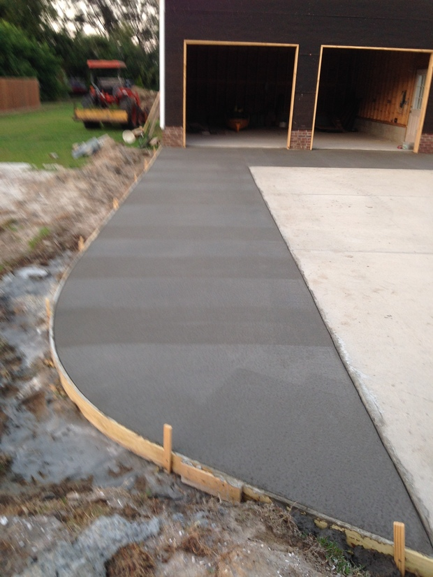 Traditional driveway in kitty hawk widening driveway for Driveway addition ideas