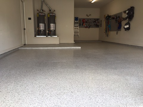 Casual / Comfortable Garage with gray speckled epoxy floor