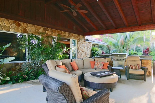 Tropical Outdoor Kitchen With Covered Living Space