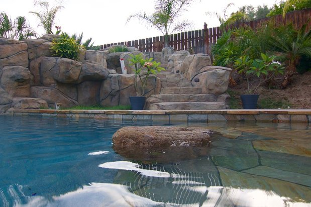 Tropical pool in temecula stone steps to pool slide for Landscaping rocks temecula