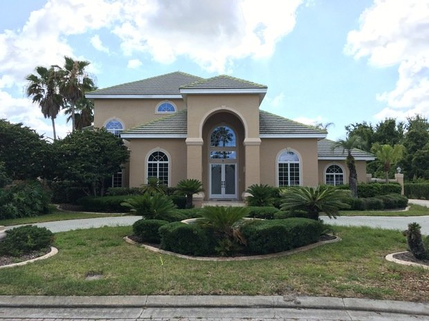 tropical home exterior in deltona by a clear view window