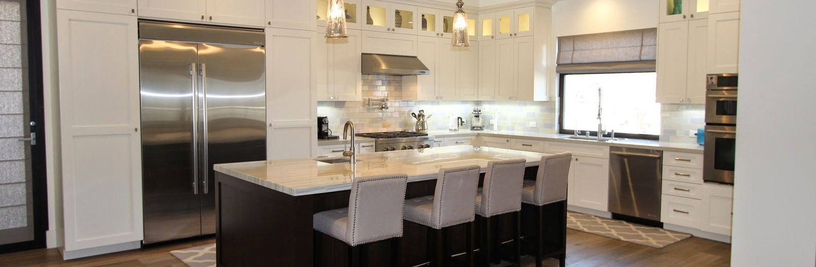 Transitional Kitchen with white recessed panel cabinets