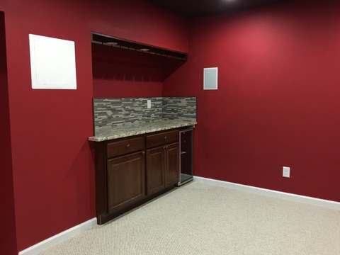 Traditional Basement with dark raised panel cabinet