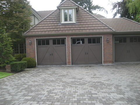 Transitional Garage with carriage garage doors