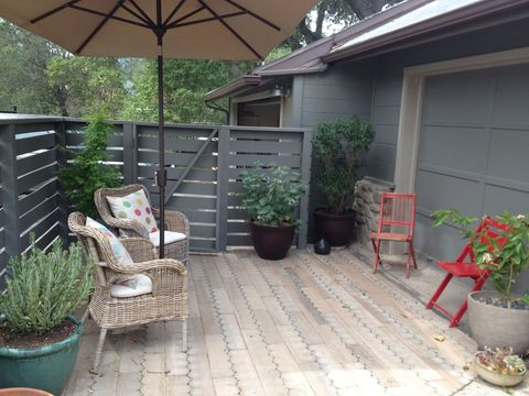 Eclectic Patio with gray panel siding