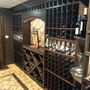 Traditional Wine Cellar with in cabinet lighting