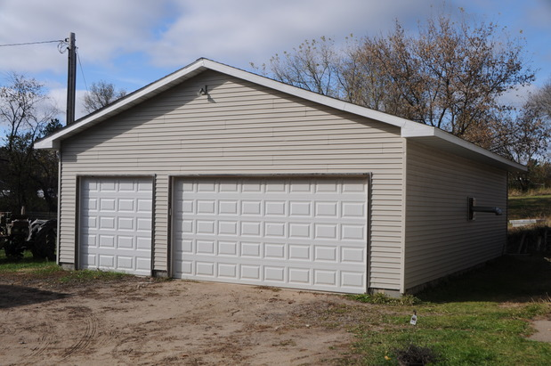 Traditional garage in blaine two door garage white for Garage doors blaine mn