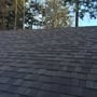 Traditional Home Exterior with black roof shingles