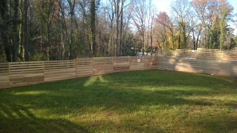 Modern Landscape with 4 foot horizntal slat and plank fence