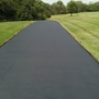 Traditional Driveway with asphalt paved driveway