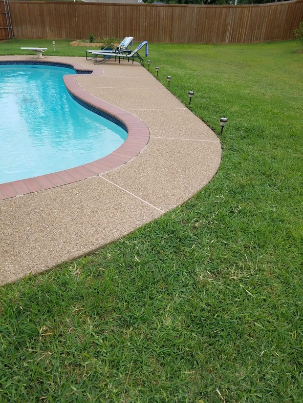 Traditional Pool With Cement Paved Patio