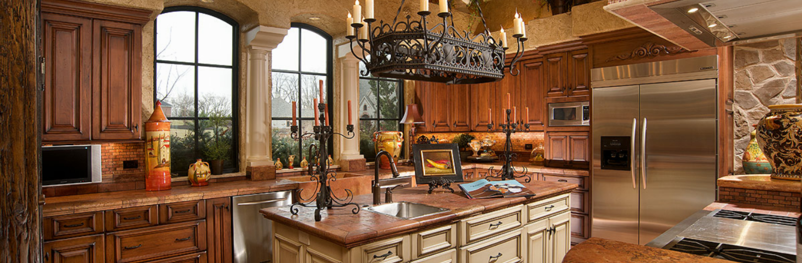 Mediterranean Kitchen with beauitful kitchen island with sink