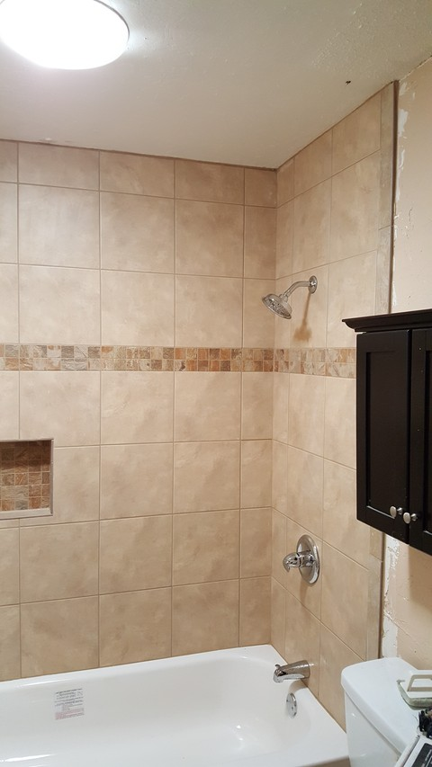 Traditional Bathroom with tile shower niche