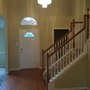 Transitional Entry with white wood turned balusters