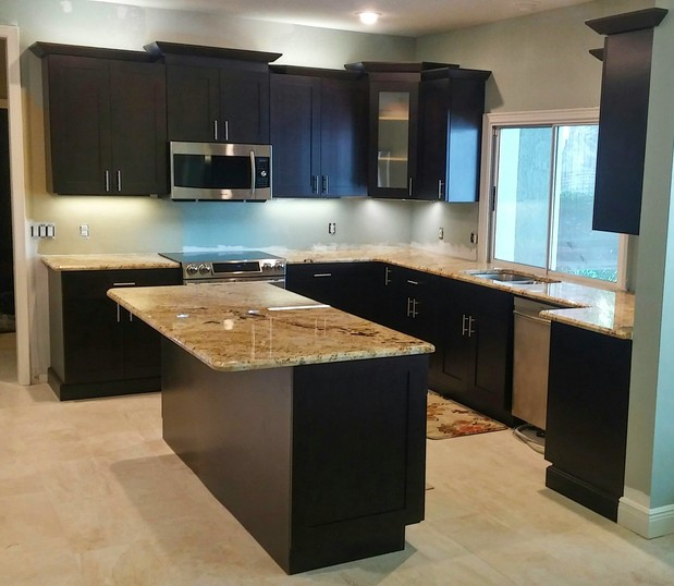 transitional kitchen in orlando recessed panel cabinetry black cabinetry by the home design