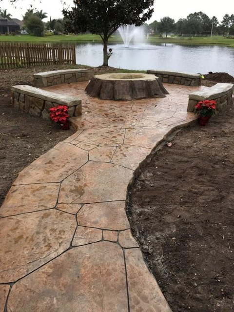 Eclectic Patio with stamped concrete flagstone walkway