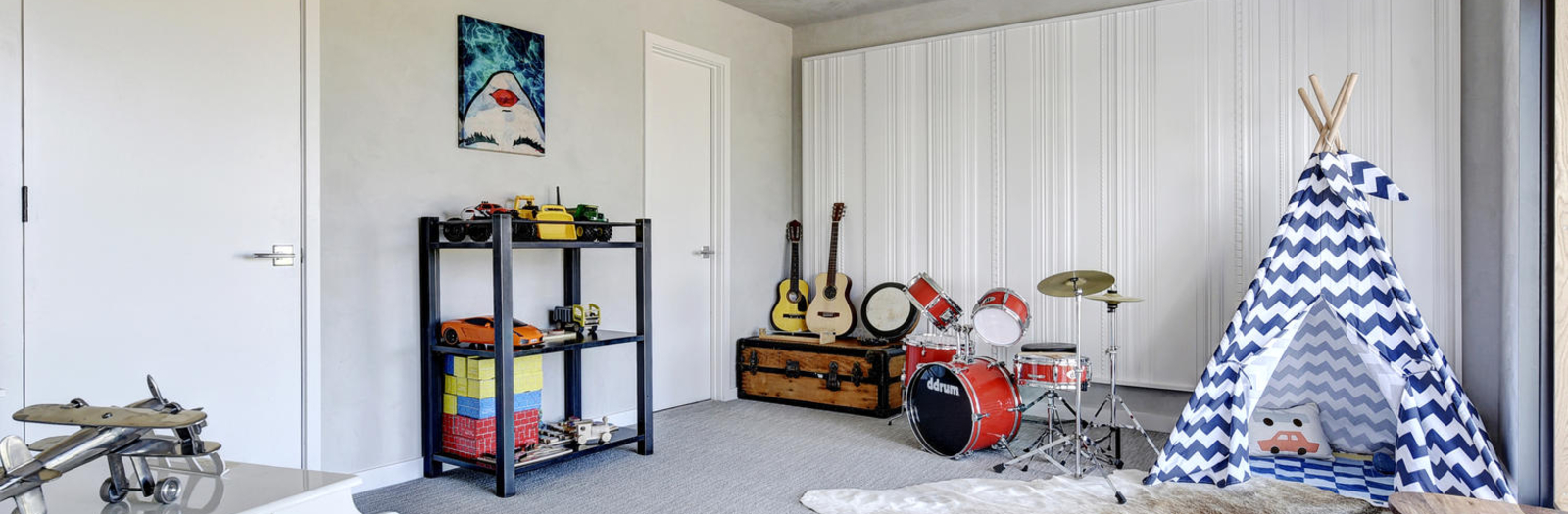 Eclectic Kids Room with decorative white wall panel