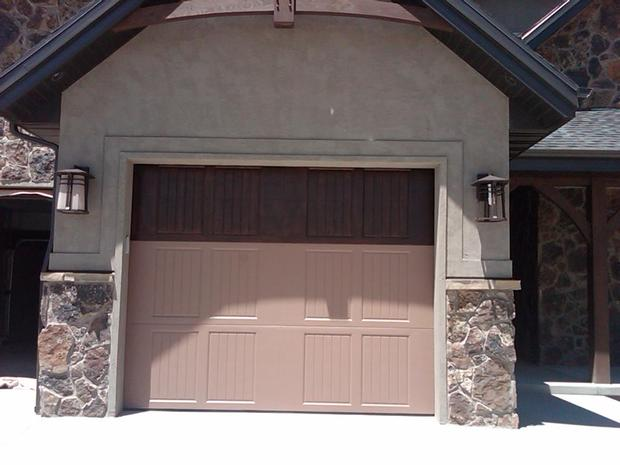 Rustic garage in provo sconce lights stucco exterior for Rustic wood garage doors
