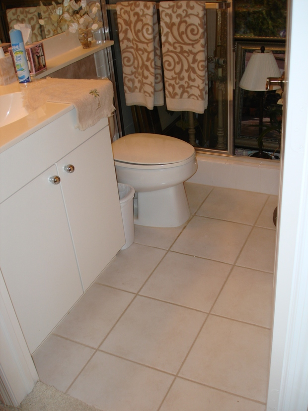 Casual Comfortable Bathroom In Lakeland Solid Surface Countertop White Vanity Cabinetry