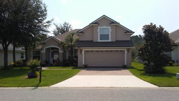 Traditional Home Exterior In Jacksonville Brick Paved Driveway Grass By Sculley Painting Inc