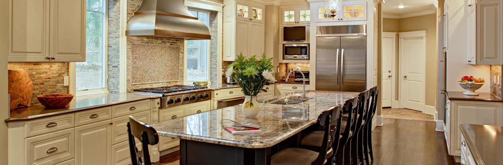 Transitional Kitchen with stainless steel and bronze range hood