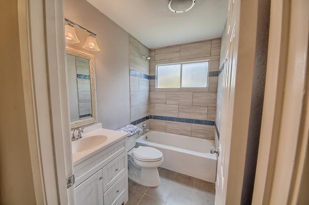 Transitional Bathroom In San Antonio Framed Vanity Mirror Tan Tile Floor By C S Enterprises