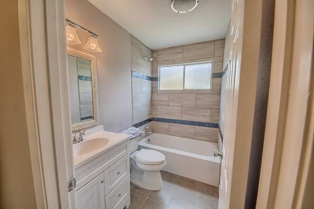 Transitional bathroom in san antonio bathtub framed for Bathroom mirrors san antonio