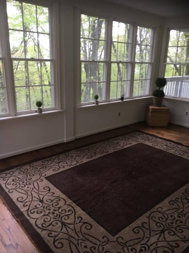Cottage Sunroom In West Chester Wood Floor White Walls