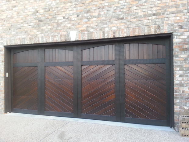 Contemporary Garage With Stained Wood Paneled Garagel Door