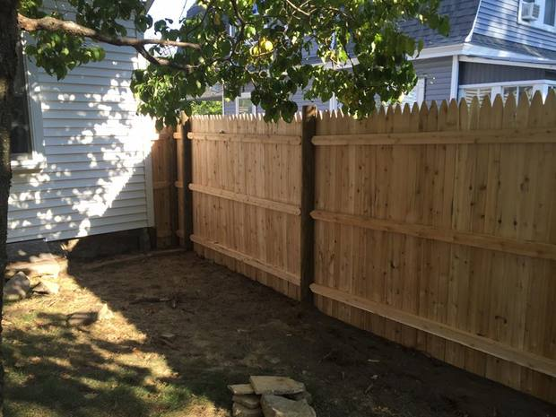 Cottage Landscape In Milford Tall Fence White Exterior
