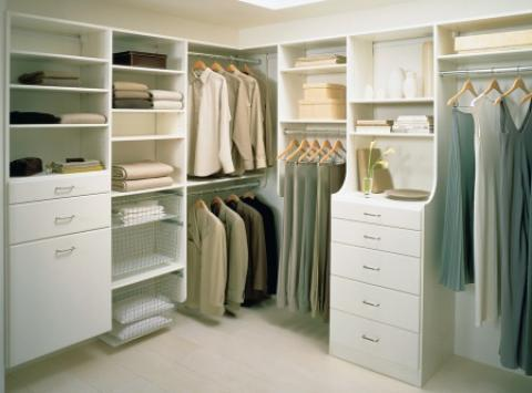 Transitional Closet with walk in closet storage