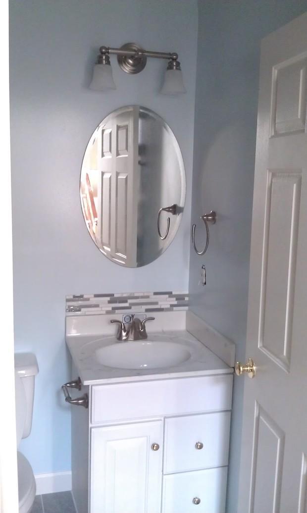 Modern bathroom in alexandria oval mirror integral sink for Bathroom vanities alexandria
