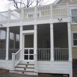 Traditional Porch with white columns holding up deck